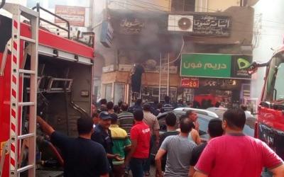 بالصور اندلاع حريق فى محل بشارع بنك مصر بمدينة المنصورة